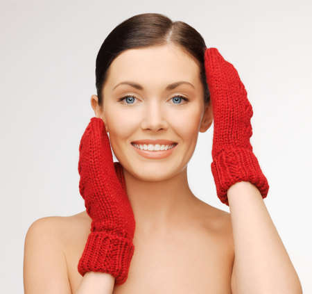 bright picture of beautiful woman in red mittens   photo