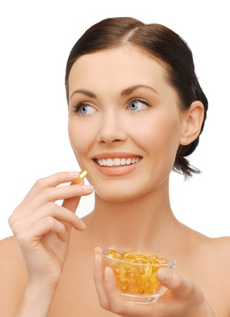 bright picture of beautiful woman with vitamins Stock Photo - 17540156