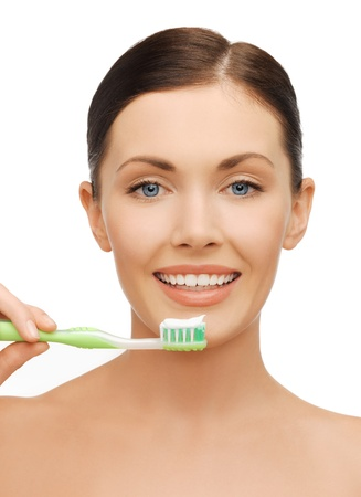 bright picture of beautiful woman with toothbrush photo