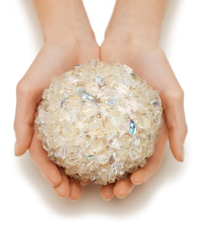 closeup picture of woman hands holding bath ball photo