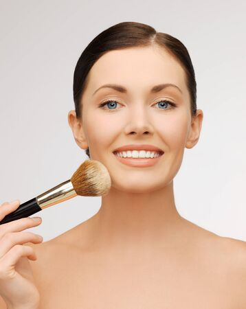 bright closeup portrait picture of beautiful woman with brush Stock Photo - 17540196