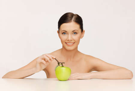 picture of beautiful woman with green apple  photo
