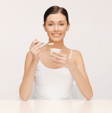 bright picture of beautiful woman with yogurt Stock Photo - 17540234