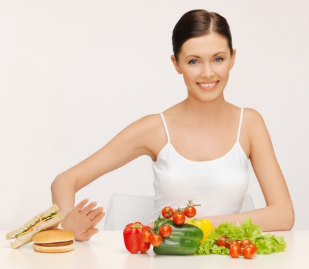 picture of beautiful woman with hamburger and vegetables Stock Photo - 17540097