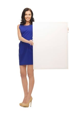 picture of lovely woman in blue dress with blank board Stock Photo - 17538778