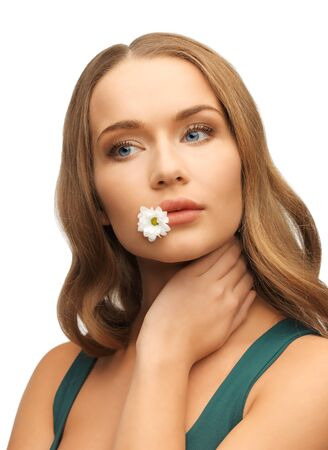 picture of beautiful woman with camomile in mouth Stock Photo - 17540247