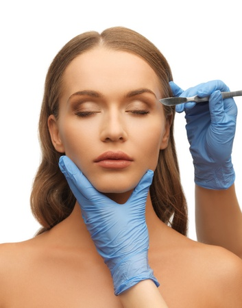 picture of woman face and beautician hands with scalpel Stock Photo - 17540205