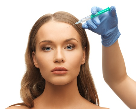 picture of woman face and beautician hands with syringe Stock Photo - 17540160
