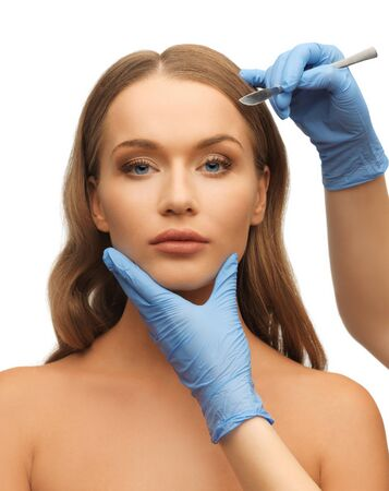 picture of woman face and beautician hands with scalpel Stock Photo - 17540250