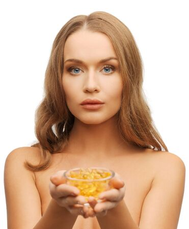 bright picture of beautiful woman with vitamins Stock Photo - 17540237