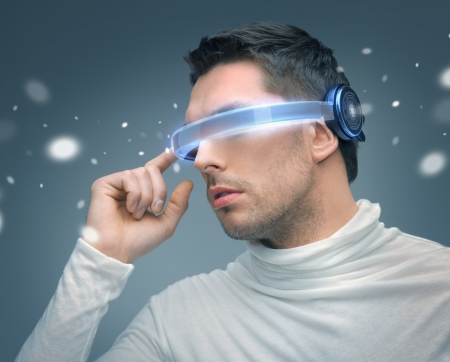 VIRTUAL REALITY: picture of handsome man with futuristic glasses