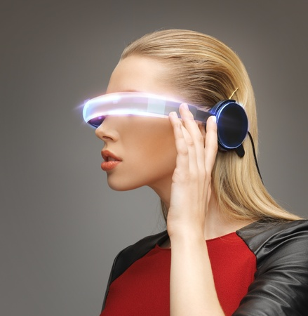 VIRTUAL REALITY: picture of beautiful woman with futuristic glasses Stock Photo