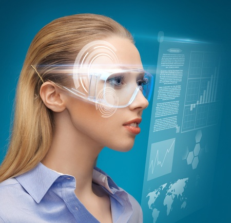 high tech world: picture of beautiful woman with futuristic glasses Stock Photo