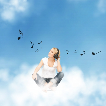 picture of happy teenage girl in big headphones sitting on cloud Stock Photo - 17602408