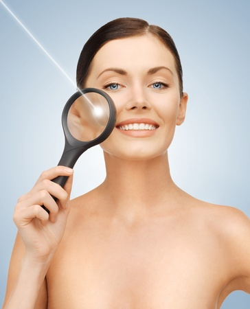 laser surgery: bright picture of beautiful woman with magnifying glass and laser