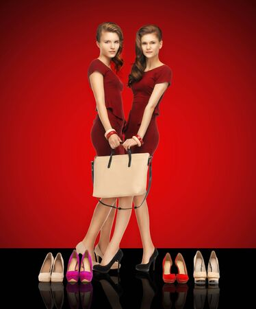 dress shoe: picture of two teenage girls in red dresses with bag