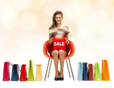 picture of teenage girl in red dress with shoes, bag and sale sign photo