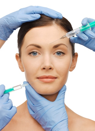 picture of woman face and beautician hands with syringes photo
