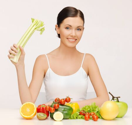 picture of beautiful woman with fruits and vegetables photo