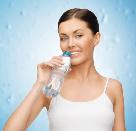 picture of woman in blank t-shirt with bottle of water photo