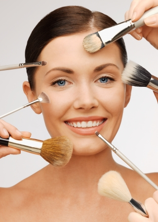 make up brush: bright closeup portrait picture of beautiful woman with brushes