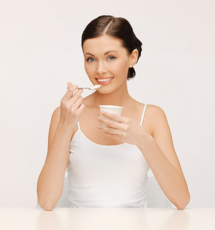 bright picture of beautiful woman with yogurt Stock Photo - 17602413