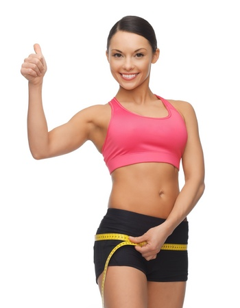picture of sporty woman measuring her hips photo