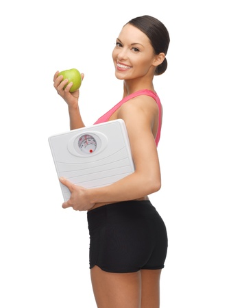 scale weight: picture of sporty woman with apple and weight scale