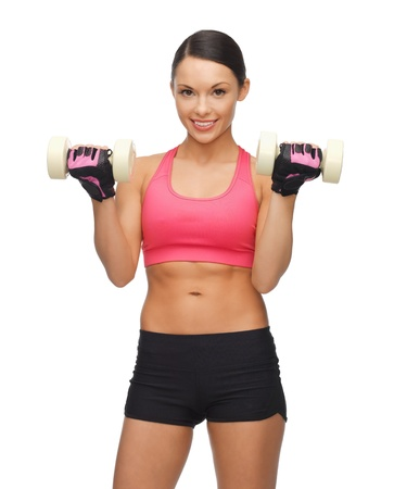 picture of beautiful sporty woman with dumbbells photo