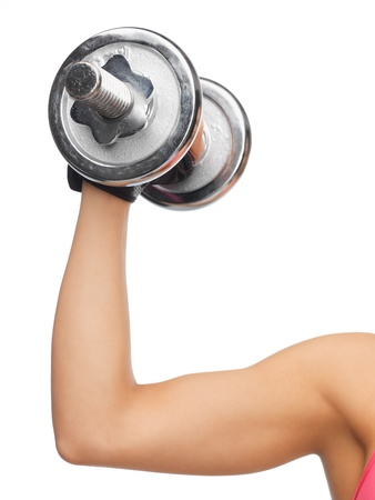 closeup picture of sporty woman with dumbbell photo