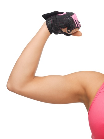 flex: closeup picture of sporty woman flexing her biceps
