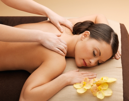 hands massage: picture of calm beautiful woman in massage salon Stock Photo