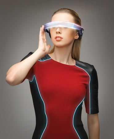 cyber woman: picture of beautiful woman with futuristic glasses Stock Photo