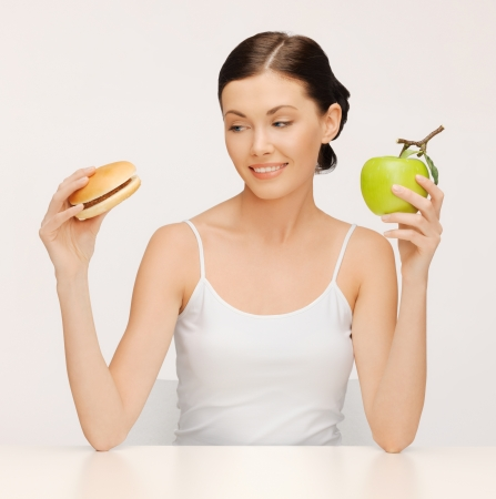 picture of beautiful woman with hamburger and apple photo
