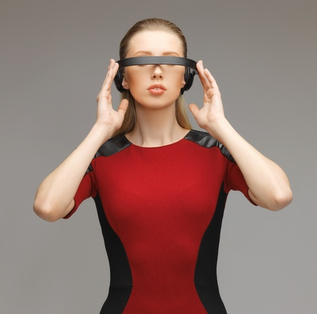 robot woman: picture of beautiful woman with futuristic glasses Stock Photo