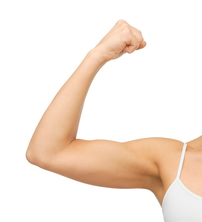 arm muscles: closeup picture of sporty woman flexing her biceps