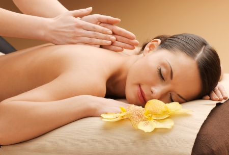 picture of happy beautiful woman in massage salon photo