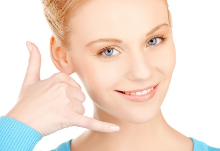 picture of beautiful woman making a call me gesture Stock Photo - 17645160