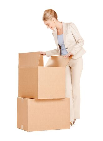 picture of attractive businesswoman with big boxes photo