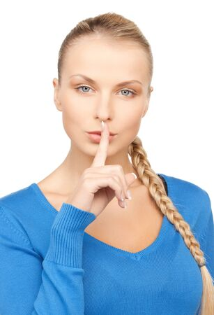 bright picture of woman with finger on lips Stock Photo - 17632236