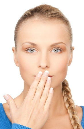 bright closeup picture of woman with hand over mouth Stock Photo - 17636346