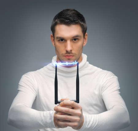 futuristic man: bright picture of futuristic man with stun gun