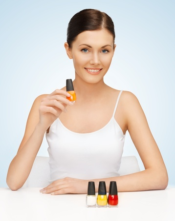 nail colour: picture of beautiful woman with nail polish bottles