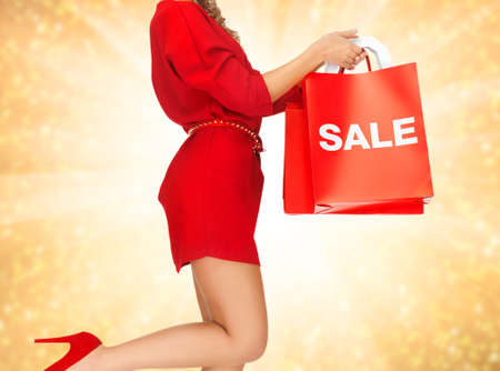 closeup picture of woman holding shopping bags photo