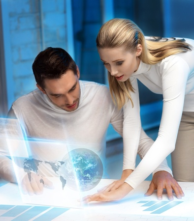 lab tech: picture of man and woman working with virtual screen Stock Photo