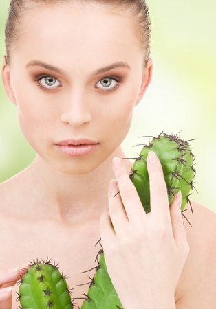 closeup portrait of beautiful woman with cactus photo