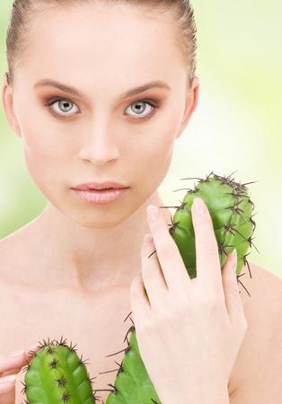 closeup portrait of beautiful woman with cactus Stock Photo - 17665138