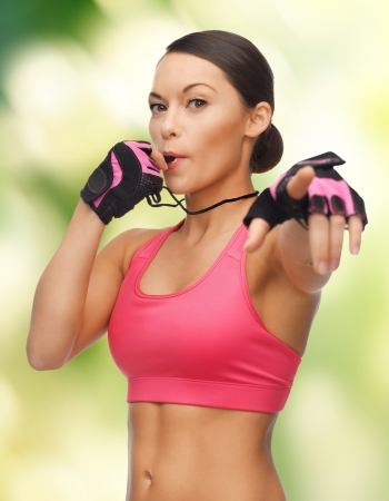 picture of beautiful sporty woman with whistle
