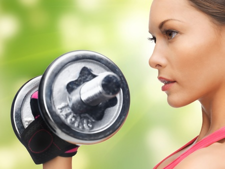 'personal beauty': picture of beautiful sporty woman with dumbbell