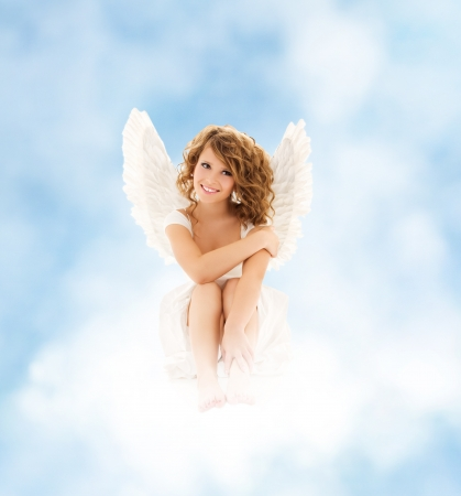 attractive angels: picture of happy teenage angel girl Stock Photo